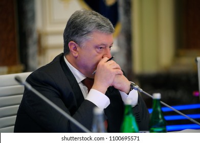 Petr Poroshenko, the President of Ukraine, listening to speaker during 1-st meeting of National Investment Council of Ukraine. May 25, 2018. Kiev, Ukraine