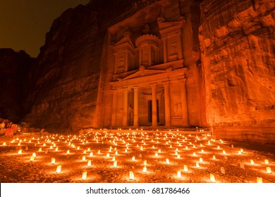 Petra by night (candlelit) and the Treasury monument (Al-Khazneh) in Petra archaeological site, Jordan.
