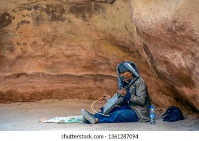 Petra / Jordan - 4 Nov 2018: Bedouin Musician Busking at Petra