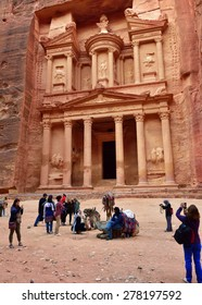 PETRA, JORDAN - APR 1, 2015: Tourists visit the  Petra - UNESCO world heritage site and one of The New 7 Wonders of the World.