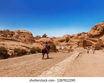 PETRA, JORDAN - APRIL 18, 2012:The road between the red cliffs to the ancient city of Petra, Jordan