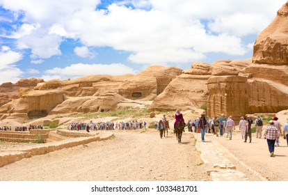 PETRA, JORDAN - APRIL 25, 2016: Tourists travellers visiting Petra in Jordan during spring vacation. Petra, Jordan - April 25, 2016