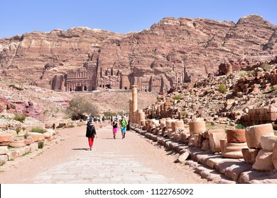PETRA, JORDAN - CIRCA MARCH 2018: Tourists walk around the Petra ruins with famous Al-Khazneh (The Treasury).
