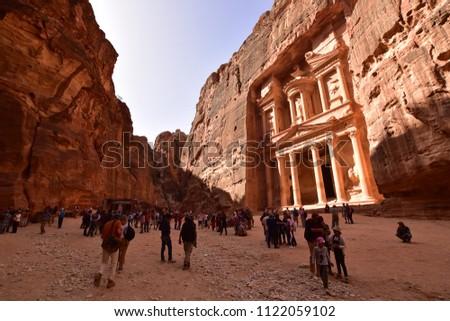 a5d63435626 PETRA, JORDAN - CIRCA MARCH 2018: Tourists walk around the Petra ruins with  famous