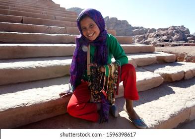 Petra, Jordan. December 13th 2012Jordanian Bedouin girl selling beads to tourists Petra Jordan
