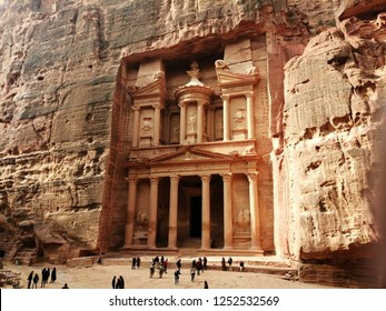 Petra, Jordan - December 4, 2018 : The  Treasury is one of the most elaborate temples in the ancient Arab Nabatean Kingdom city of Petra. As with most of the other buildings in this ancient town