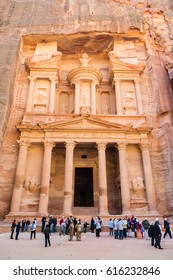 PETRA, JORDAN - FEBRUARY 21, 2012: people on square near al-Khazneh temple (The Treasury) in Petra town. Rock-cut town Petra was established about 312 BC as the capital city of the Arab Nabataean