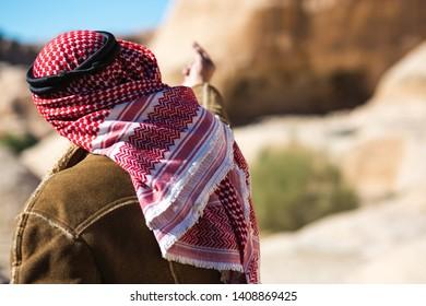 Petra, Jordan - January 9 2018: A Jordanian man guides people through the ancient city.