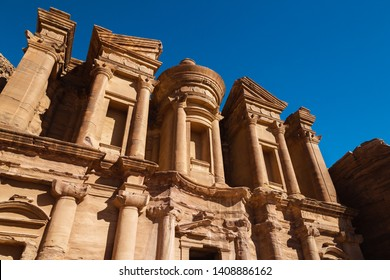 """Petra, Jordan - January 9 2018: Ad Deir or """"The Monastery"""" is a structure cut from the sandstone."""