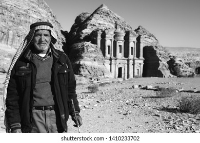 Petra, Jordan - January 9 2018: A Bedouin Man Shows off the Monastery in Petra.