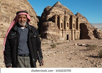 Petra, Jordan - January 9 2018: A Bedouin Man Shows off the Monastery in Petra.