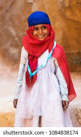 Petra, Jordan - March 21, 2018: Young Bedouin Girl Performing for Money and Tips on Siq at Petra