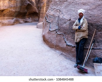 Petra, Jordan - March 21, 2018: Bedouin Man Working on the Siq on way to Ruins at Petra