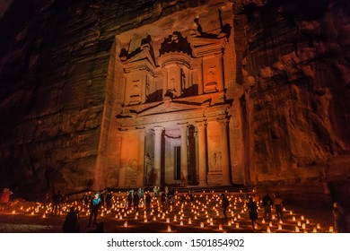PETRA, JORDAN - MARCH 22, 2017: Tourists visit the Al Khazneh temple (The Treasury) during Petra by Night in the ancient city Petra, Jordan