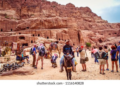 PETRA / JORDAN - MAY 04, 2018 : Tourists walk around the Petra ruins.