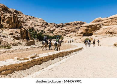 Petra, Jordan -  May 08, 2019: tourists on the way to the historical and archaeological city of Petra