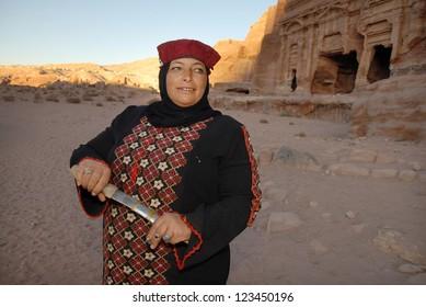 PETRA, JORDAN - NOV 09:A Jordanian Bedouin woman holds a knife in Petra, Jordan on November 09 2007.Petra was originally the capital city of the Nabataeans, an ancient Arab civilization.