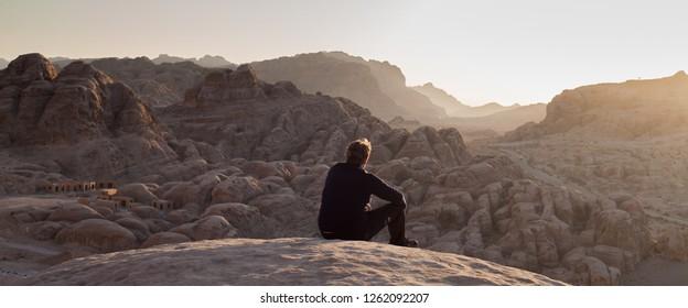 PETRA, JORDAN - NOVEMBER 19, 2018: young man in the desert, Petra, Jordan