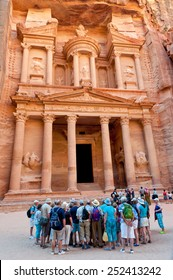 Petra, Jordan - November 20, 2010: Crowds of tourists near the Treasury in the Ancient city of Petra carved out of the rock at November 20, 2010 in Petra, Jordan