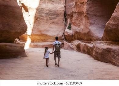 PETRA, JORDAN - OCTOBER 29, 2014: Unidentified tourists in the Siq - natural narrow passageway to Petra