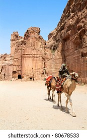PETRA, JORDAN - SEP 25: Unidentified Bedouins provide tourist camel rides through the ruins of ancient Petra on September 25, 2010 in Petra, Jordan. Petra is a UNESCO World Heritage Site since 1985.