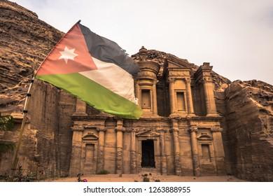 Petra - October 01, 2018: Jordanian flag at the monastery of the ancient city of Petra, Wonder of the World, Jordan