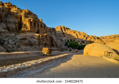 Petra, Wadi Musa, Jordan – August 8, 2018: A horse carriage at Petra archaeological city entrance in the early morning light