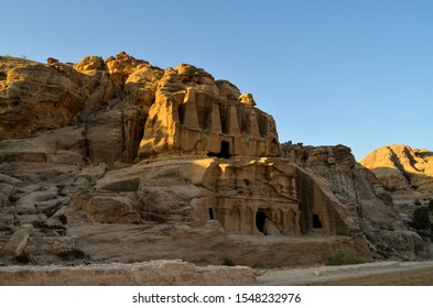 Petra, Wadi Musa, Jordan – August 8, 2018: Ancient ruins at Petra archaeological park entrance at sunrise