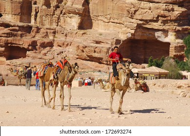 PETRA-JORDAN NOV 25:Unidentified man looks for tourists for camel ride on Nov 25, 2009 Petra, Jordan. Ride cost 20JD. Petra was the impressive capital of the Nabataean kingdom.