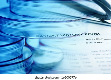 Petri dishes and patient history form. Medical concept.