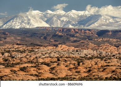 Petrified sand dunes with the La Sal Mountains in the background in Arches National Park near Moab, Utah