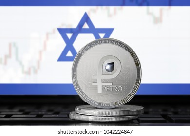 PETRO (PTR) cryptocurrency; coin el petro on the background of the flag of Israel; national Venezuela cryptocurrency