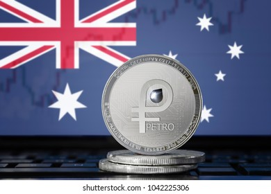 PETRO (PTR) cryptocurrency; coin el petro on the background of the flag of Australia (Australian Union); national Venezuela cryptocurrency