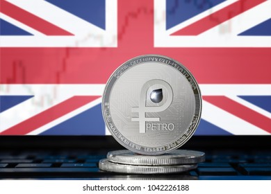 PETRO (PTR) cryptocurrency; coin el petro on the background of the flag of United Kingdom of Great Britain and Northern Ireland (UK); national Venezuela cryptocurrency