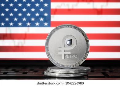 PETRO (PTR) cryptocurrency; coin el petro on the background of the flag of United States of America (USA); national Venezuela cryptocurrency