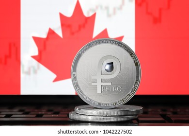 PETRO (PTR) cryptocurrency; coin el petro on the background of the flag of Canada; national Venezuela cryptocurrency