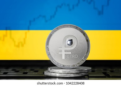 PETRO (PTR) cryptocurrency; coin el petro on the background of the flag of Ukraine (UA); national Venezuela crypto currency