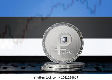 PETRO (PTR) cryptocurrency; coin el petro on the background of the flag of Estonia (Republic of Estonia); national Venezuela cryptocurrency