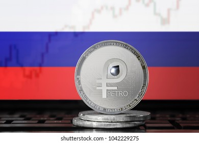 PETRO (PTR) cryptocurrency; coin el petro on the background of the flag of Russia (Russian federation); national Venezuela cryptocurrency