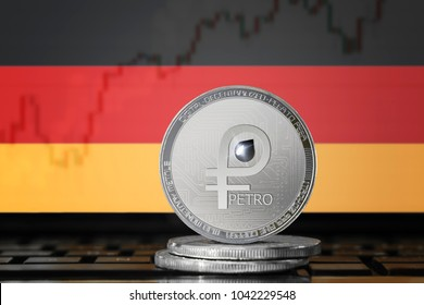 PETRO (PTR) cryptocurrency; coin el petro on the background of the flag of Germany; national Venezuela cryptocurrency