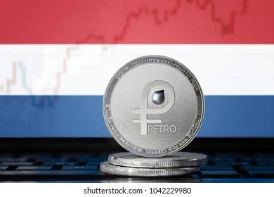 PETRO (PTR) cryptocurrency; coin el petro on the background of the flag of Netherlands; national Venezuela cryptocurrency