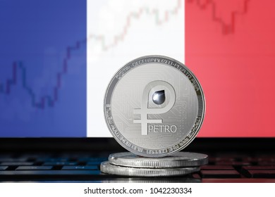 PETRO (PTR) cryptocurrency; coin el petro on the background of the flag of France (French Republic); national Venezuela cryptocurrency
