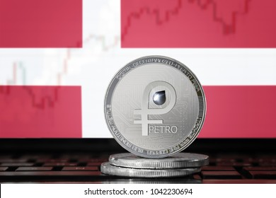 PETRO (PTR) cryptocurrency; coin el petro on the background of the flag of Denmark (Kingdom of Denmark); national Venezuela cryptocurrency