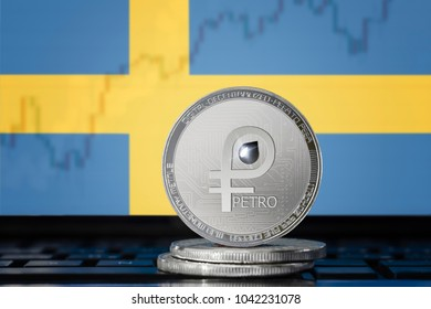 PETRO (PTR) cryptocurrency; coin el petro on the background of the flag of Sweden (Kingdom of Sweden); national Venezuela cryptocurrency