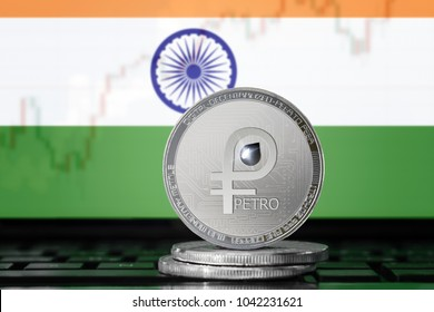 PETRO (PTR) cryptocurrency; coin el petro on the background of the flag of India; national Venezuela cryptocurrency
