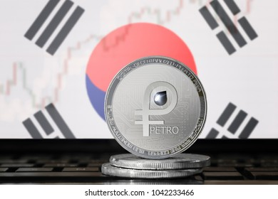 PETRO (PTR) cryptocurrency; coin el petro on the background of the flag of South Korea; national Venezuela cryptocurrency