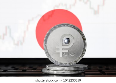 PETRO (PTR) cryptocurrency; coin el petro on the background of the flag of Japan; national Venezuela cryptocurrency