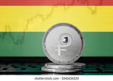 PETRO (PTR) cryptocurrency; coin el petro on the background of the flag of BOLIVIA; national Venezuela cryptocurrency