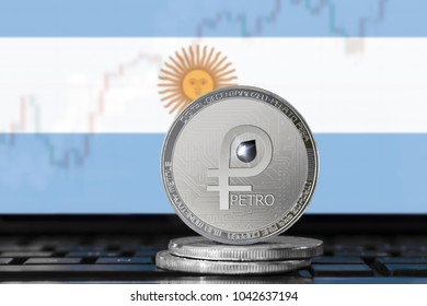 PETRO (PTR) cryptocurrency; coin el petro on the background of the flag of ARGENTINA; national Venezuela cryptocurrency