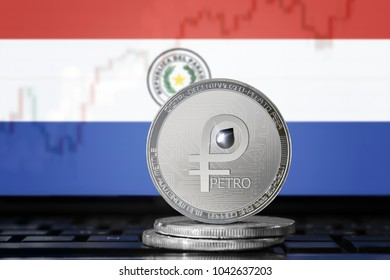 PETRO (PTR) cryptocurrency; coin el petro on the background of the flag of Paraguay; national Venezuela cryptocurrency
